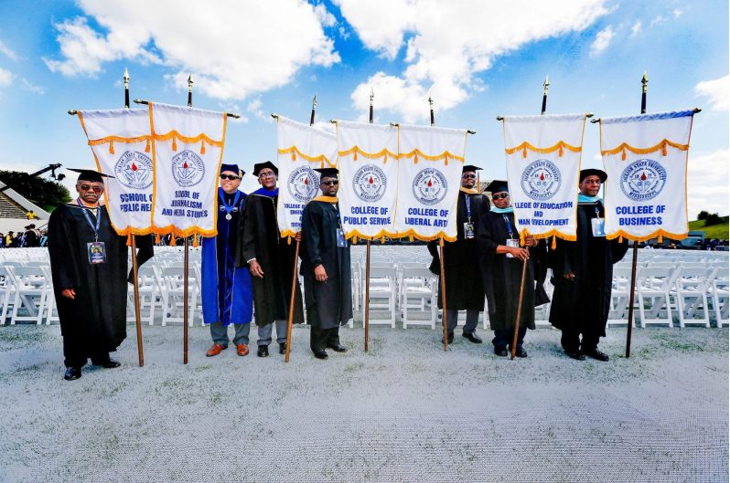 Photo of seven scholars at graduation