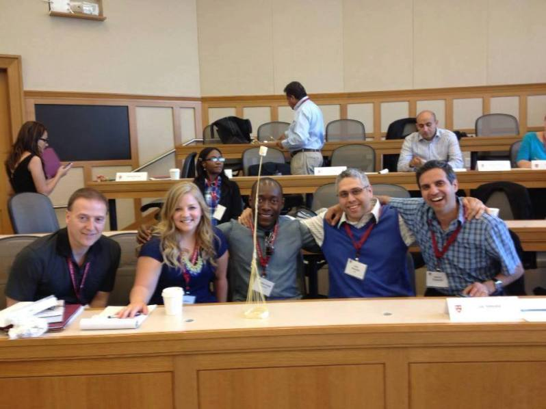 Photo of Dr. Almeida at Harvard University with corporate leaders.