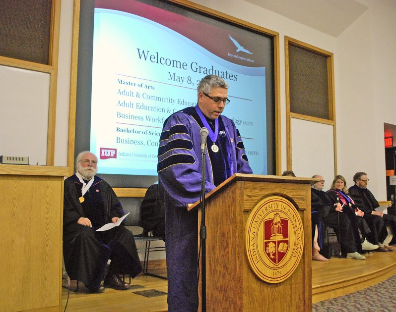 Photo of Dr. A Dr. A Serving As Master of Ceremonies at IUP, 2015.