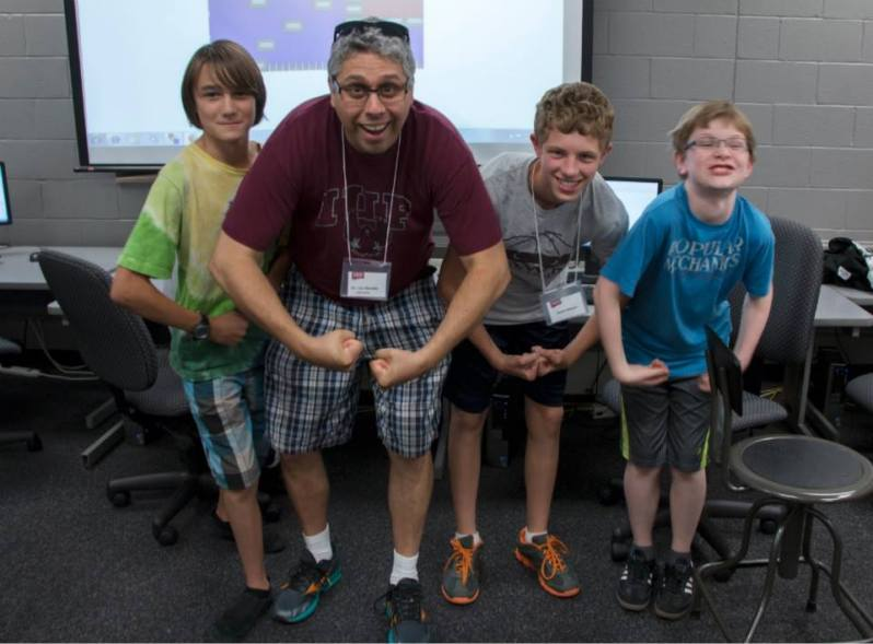 Photo of Dr. A Teaching 11 year Old Kids How To Make Video Games.
