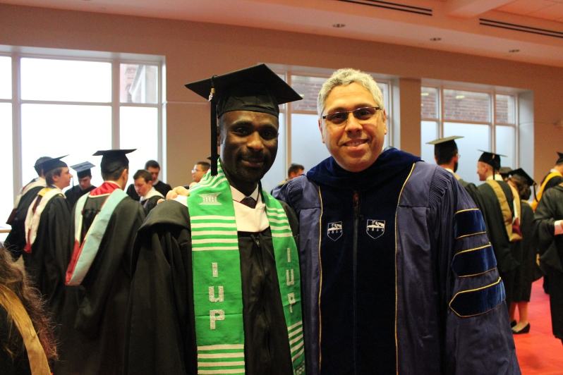 Photo of Dr. A And Aliyu At Fall Graduation Indiana University of PA. Aliyu Now Works At Voice Of America.