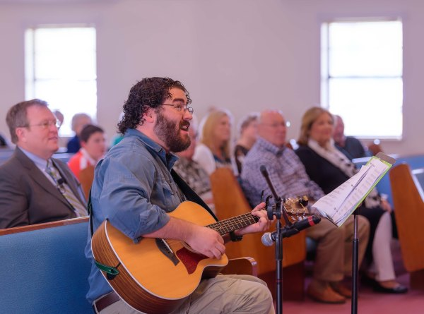 Photo of Man Playing The Guitar In Church