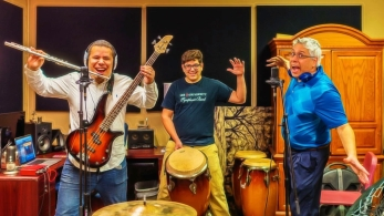 Photo of Dr. A Collaborating With Jose Valentino And His Student Robert In A Rap Song!
